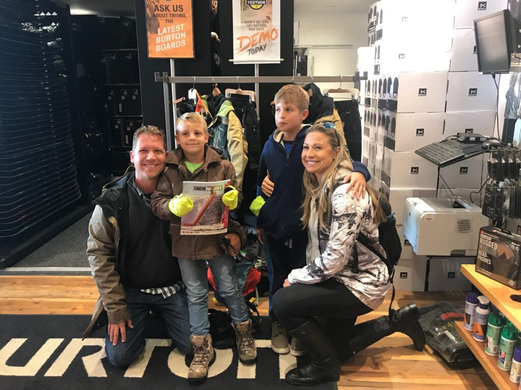 Family posing in sporting goods store